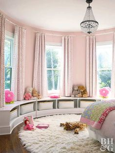 Multiple shades of pink combine with crisp white to create a warm and cozy reading nook in this girl's bedroom. The patterns used stay away from overtly childish themes, sticking instead to classic florals for a timeless look that can age with your child.