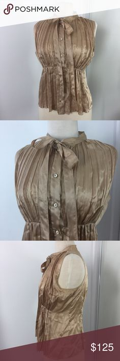 "Prada AUTHENTIC Sleeveless Pleated Blouse Prada Gold Sleeveless Button Down Blouse with High Neck tie.  100% silk.  There is a spot on silk on the side as shown in photo.  Approx 17"" armpit to armpit and 22"" length.  Italy size 44 converts to US 10.  Totally authentic.  C1. Prada Tops Blouses"