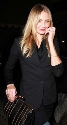 Who made Cameron Diaz's black and gold clutch? Purse – Ember Skye