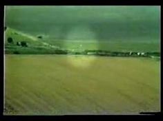 I have found actual footage of the 'balls of light' that I keep thinking about that I have seen before.  Amazing! Crop Circles Quest for Truth: Balls of Light  http://www.colinandrews.net/UFO-BallsOfLight-Orbs.html
