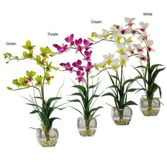 This vibrant silk flower arrangement comes complete with a modern glass vase. The stunning silk orchid display is available in a range of colors to decorate any indoor living area. An illusion liquid-filled glass completes this beautiful arrangement.