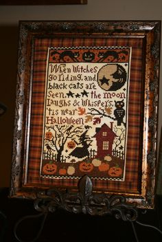 """Autumn Prairie Schooler cross stitch framed with a fabric """"mat"""""""