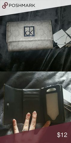 Calvin Klein CK logo wristlet Cream metallic color. Used for iPhone 5, received as a gift and never used. Calvin Klein Bags Clutches & Wristlets