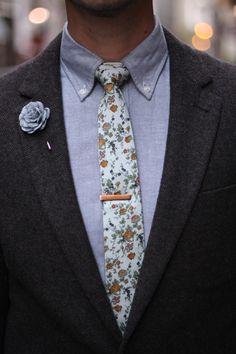 Brown tweed jacket, Blue grey oxford shirt, floral tie, grey lapel pin, rose gold tie clip