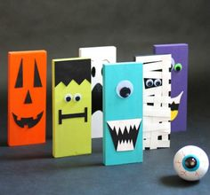 The six 9-inch-tall pins are cut from 4.5 feet of 1x4-inch wood. After sanding down the edges, you can decorate them as whatever spooky creature you'd like using googly eyes, construction paper, and markers. Players bowl using a bouncy ball painted to look like an eye.
