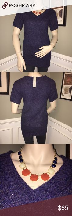 J. Crew Navy Blue Short Sleeve Wool Tunic This sweater is very warm yet very liberating with its short sleeves. Although it is too short to be worn as a dress, it looks best over tighter bottoms to give it the sweater dress impression. It would look great with a belt worn at the waist as well. J. Crew Sweaters Crew & Scoop Necks