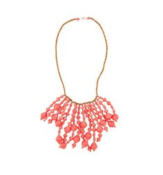 $52.00 Dazzle your way through spring with this statement necklace! The Razzle Dazzle necklace is sure to turn heads, with a waterfall of large and small beads. Available in Coral, Light Green, and Blue