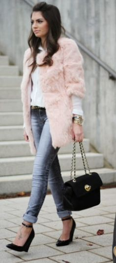 Love the pink fuzzy jacket and the understated jeans and shirt.  She's got my tattoo. :/