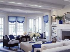 Bright, airy, and casually elegant, these interiors reflect fine New England style. Blue tones take center stage for a look that's classic and crisp. Dark mahogany furniture with navy and white fabric adds yacht-like appeal.