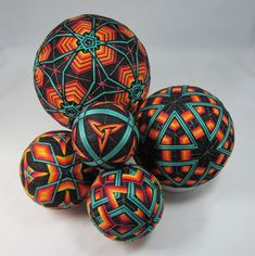 Bursting kaleidoscopes of color, temari balls are an ancient Japanese tradition. These examples, covered with geometric patterns, are sure to delight. Yarn Crafts, Sewing Crafts, Temari Patterns, Geometric Designs, Geometric Patterns, Fire And Ice, Christmas Centerpieces, String Art, Fiber Art