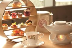 Afternoon tea at The Ritz-Carlton, Toronto. High tea stand designed by Glass…