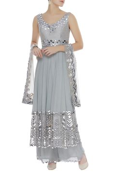 Showcasing stellar silver-grey hues, this beautiful sharara featuring foil & leather applique work, paired with zig-zag hem palazzo pants & dupatta.Set of threeRent:?Altered to your sizeSleeves:? Simple Pakistani Dresses, Indian Gowns Dresses, Pakistani Dress Design, Indian Attire, Indian Outfits, Pakistani Outfits, Anarkali, Sharara, Lehenga