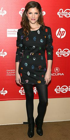 Last Night's Look: Love It or Leave It? | ANNA KENDRICK | Those would be gems printed all over the actress's black mini, accessorized with opaque tights and Louboutin booties. She sports the rubies, diamonds, emeralds and sapphires (sans bodyguard) at the premiere of The Voices in Park City, Utah, at the Sundance Film Festival.