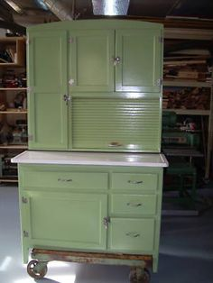 a wall of kitchen cabinets green hoosier cabinet on back porch to be repurposed into 10403