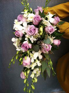 Purple wedding. Cascading bouquet. white orchids. lavender roses.
