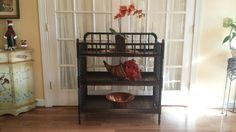 Restyled Jenny Lind changing table transformed into stylish shelf! Shelf is painted black with reclaimed wood shelves.