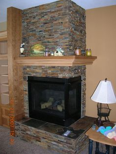 decoration inspiring corner stone fireplace mantels surrounds with slate fireplace mantel Propane Fireplace, Build A Fireplace, Slate Fireplace, Fireplace Hearth, Home Fireplace, Fireplace Design, Corner Fireplace Mantels, Fireplace Tv Stand, Fireplace Ideas