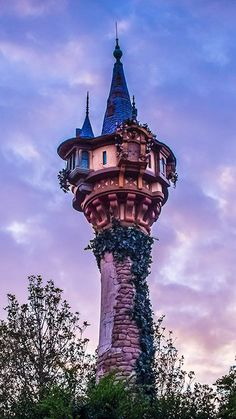 Rapunzel's tower from Tangled in Fantasyland at Walt Disney World's Magic Kingdom against a similarly colored sunset sky. Read all about it at Burnsland!