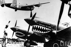 WWII Fighter planes,...with offensive nicknames and all.