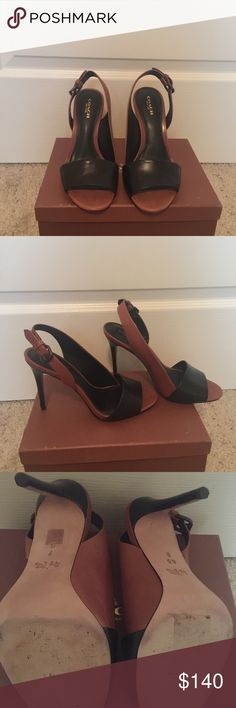 Coach sling back heels in black and saddle(tan). Size 7 - Coach sling back heels. Lightly worn like new. No nicks or scrapes to the shoe. Coach Shoes Heels
