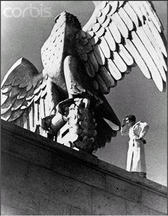 leni riefenstahl standing next to the stone eagle on the top of the zepellin parade grounds in nuremberg Nuremberg Rally, Leni Riefenstahl, Berlin Photos, Nazi Propaganda, World War Two, Historical Photos, Wwii, Movie Stars, Photo Art