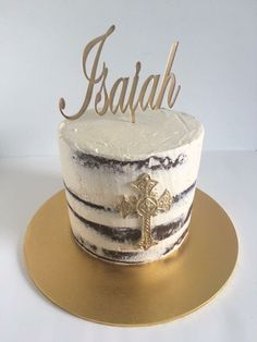 Simple yet beautiful semi nake caked christening cake with a gold acrylic topper.