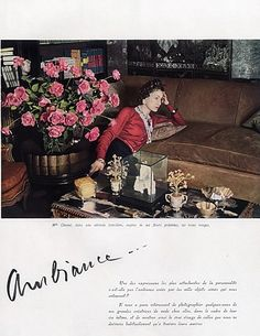 Coco Chanel, her custom suede couch & her favorite roses, in her Paris apartment