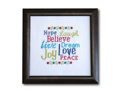 Hope Laugh Believe Live Dream Joy Love Peace. Make these Words to Live By cross stitch pattern with vintage-style floral cross stitch border. This