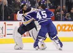 Ryan Miller, left, and Toronto Maple Leafs goaltender Jonathan Bernier fight during the third period at the Air Canada Centre. / John E. Sok...
