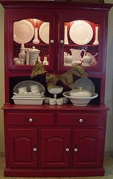 Love this red hutch with the chicken wire on the doors!