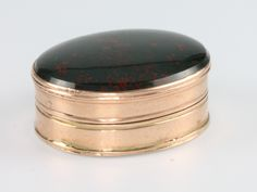 "LOT 680M A 19th Century yellow gold and hardstone set vinaigrette 1"" SOLD £320"