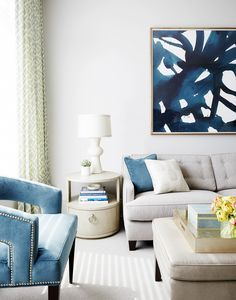 What's the color palette of your living room? This white, tan and blue combination is so refreshing and sophisticated