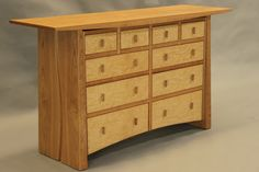 """Meander"" 10 drawer chest in cherry and curly maple"