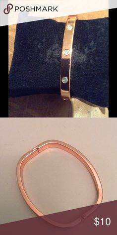 Bracelet Rose gold with silver screws NWT Fashion bracelet rose gold with silver screws.closes on one side Jewelry Bracelets