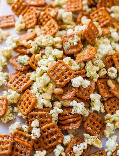 Parmesan Ranch Snack Mix  2/3 cup oil  1 one-ounce packet ranch dip powder about 4 cups popcorn, 3 1/2 cups pretzels, 1/2 to 1 peanuts,  3 oz Parm cheese, grated In a large microwave-safe bowl, add oil, ranch mix. Add popcorn, pretzels, nuts. Toss to evenly coat the mixture. Heat on high power for 2 minutes, stopping after 1 minute to toss the mixture. Add the Parmesan and toss to coat evenly. Serve mix immediately. Mix will keep for up to three days