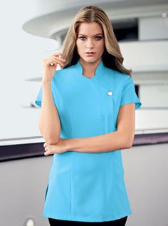 Ladies crystal blue, one button healthcare tunic., concealed zip and action back for comfort. We are a supplier of nurse's and medical uniforms to the NHS, cosmetic surgeries, dentists and private practices.