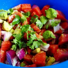 Watermelon salad with sweet red onion, lime juice, avocado, and fresh cilantro.