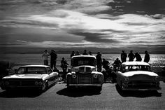 [absolutely LOVE this photo! 4 of my favorite things... the ocean, greaser style, cars, & black and white photography].