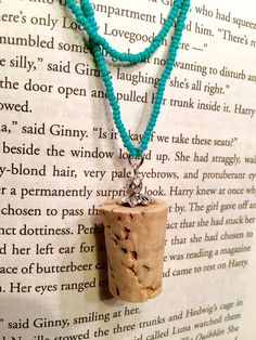 You will be just as sane as Luna keeping away the Nargles with this single strand 28 turquoise glass seed bead necklace and Butterbeer-style cork pendant with embellished metal bead and bead cap. Of course, its roomy enough to wrap around for Lunas signature double strand look.