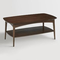 Boasting wooden construction with a rich walnut finish, our coffee table features a sleek profile and tapered legs inspired by mid-century modern Danish design. With a bottom shelf for storing books, magazines and remotes, it's a classic living room centerpiece.