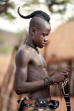 Himba Youth Has His Hair Styled in a Long Plait known as Ondatu, Namibia, Africa Photo by Nigel Pavitt