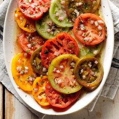 Tasty Marinated Tomatoes Recipe -My niece introduced me to this colorful recipe some time ago. I now make it when I have buffets or large gatherings because it can be prepared hours ahead. —Myrtle Matthews, Marietta, Georgia