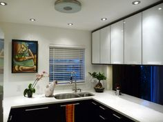 Two tone kitchen cabs- with more contemporary silhouette like the ones that we have