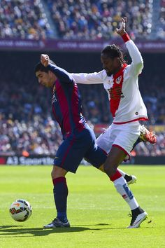Luis Suarez of FC Barcelona is brought down by Abdoulaye Ba of Rayo Vallecano during the La Liga match between FC Barcelona and Rayo Vallecano de Madrid at Camp Nou on March 8, 2015 in Barcelona, Catalonia.