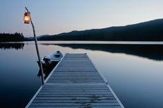 Boat on a lake at sunset with a lantern hanging. Parc national de la Gaspésie, Quebec.