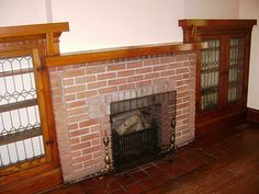 Red brick fireplace in 1940s Art Deco apartment.   CHARACTER ...