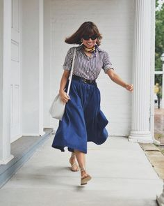 Striped shirt, midi skirt, sandals and neck scarf | Photo by Carelia (@myevolvingstyle) | For more style inspiration visit 40plusstyle.com