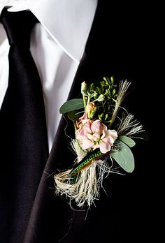 The groom, an avid fisherman, wore a boutonniere made of stock and eucalyptus, and accented with a fishing lure. Vue Photography.