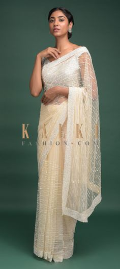 Buy Online from the link below. We ship worldwide (Free Shipping over US$100)  Click Anywhere to Tag Off White Saree In Net With Pink Thread, Beads And Sequins Work Striped Pattern Online - Kalki Fashion Off white saree in net with thread, beads and sequins embroidered striped pattern.Paired with a matching unstitched blouse with thread and sequins embroidery.