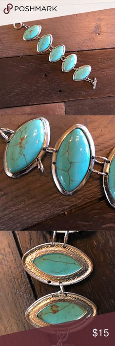 Turquoise Bracelet Beautiful turquoise and silver tone bracket. I believe this is real turquoise and not dyed stone. Jewelry Bracelets